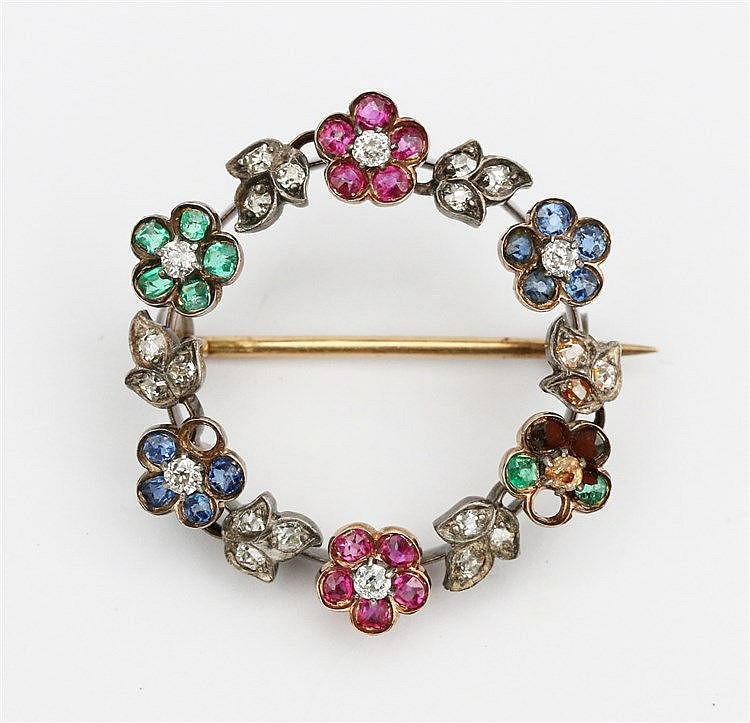 Gem set silver and gold brooch. With diamond, sapphire, ruby and