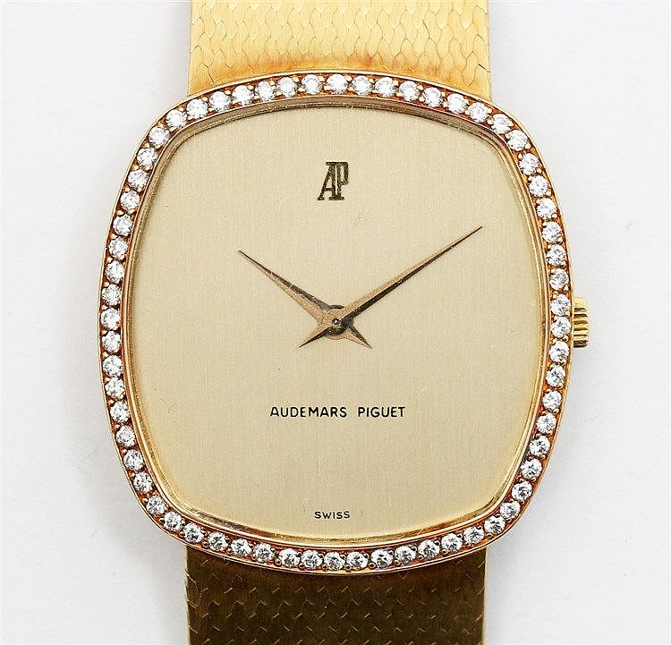 Gold Audemars Piguet watch. Numbered B1881. Cushion shaped, lune