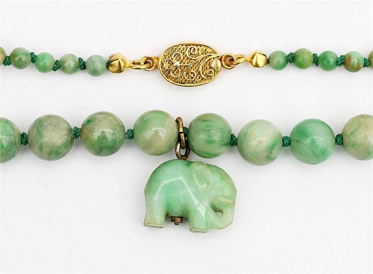 Jade necklace with elephant shaped pendant. Silver gilt clasp