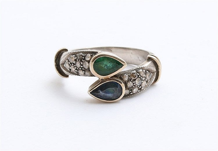 Gem set silver and gold ring. Set with pear shaped emerald, sap