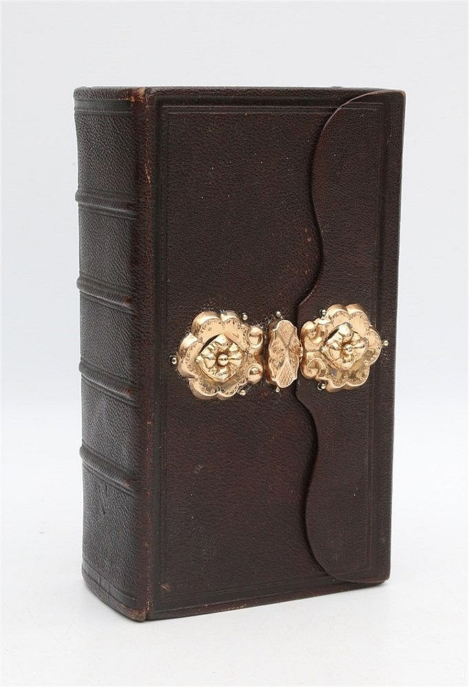Bible with gold clasp.