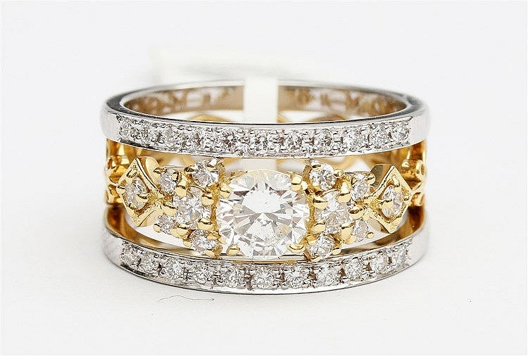 Diamond set white and yellow gold harp ring. Set with brilliant
