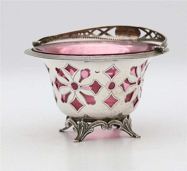 Silver potpourri basket with cranberry coloured liner by Van Kem