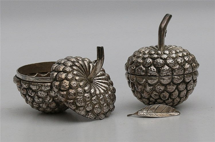 Pair of silver fruit shaped boxes. One loose leaf. Diameter 6 c