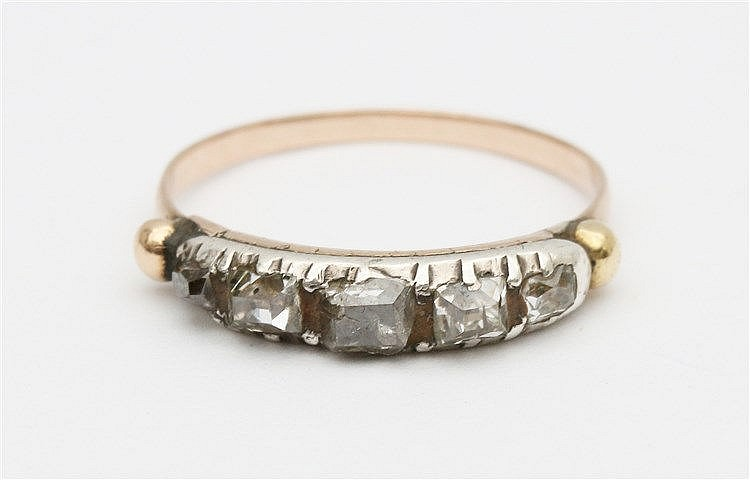 Diamond set yellow gold ring.
