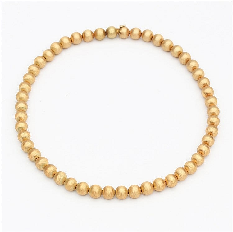 Yellow gold necklace. Made of brushed gold beads. With matching