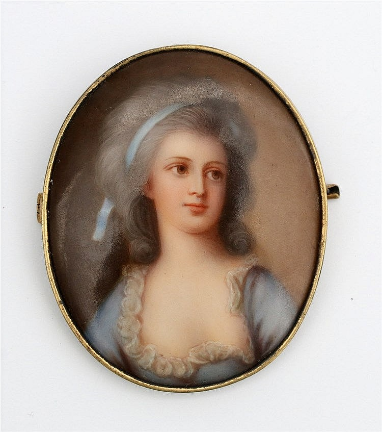 A painted miniature portrait on porcelain. Set in base metal.