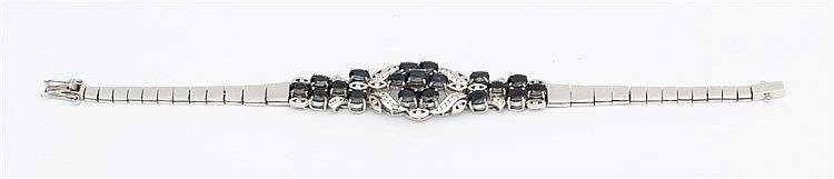 Gem set bracelet.  Diamond and sapphire set. 10 krt white gold