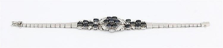 Gem set bracelet. Diamond and sapphire set. 10 krt white gold