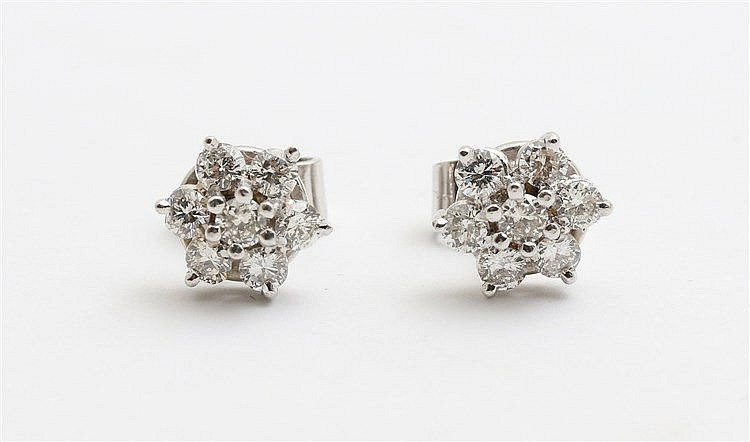 Diamond set golden earstuds. White gold. Total diamond weight a