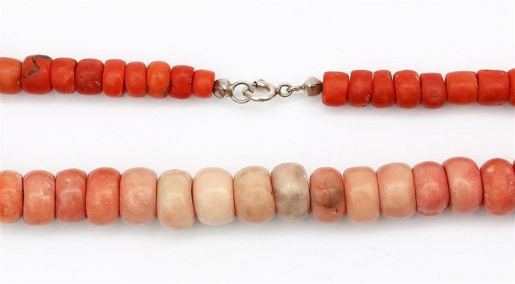 Coral necklace. Beads in different shades, dark red to faint p