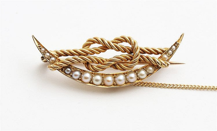 Yellow gold crescent moon brooche with love knot, circa 1900. Se