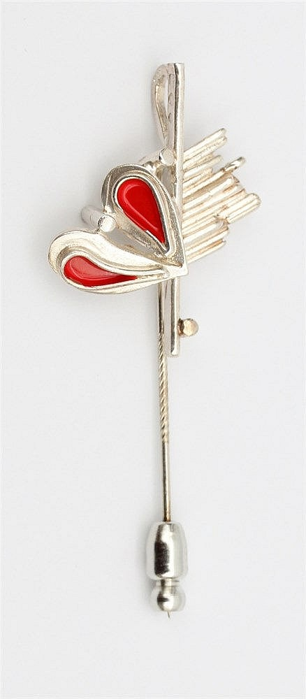 Silver pin by Anneke Schat, Dutch jewellery artist. With red a