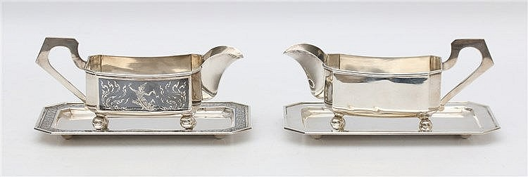 Two sterling silver sauce boats on a dish. One with niëllo decor