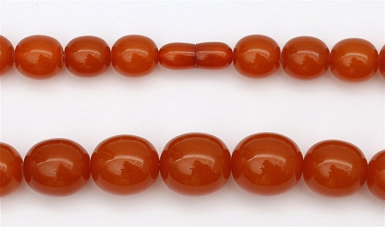 Amber necklace, egg shaped beads 14 - 21 mm. Total weight 98.0