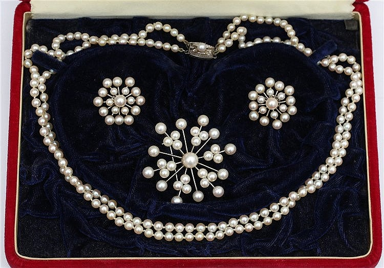 Pearl set by Mikimoto. Snowflake broche and earrings and a doubl