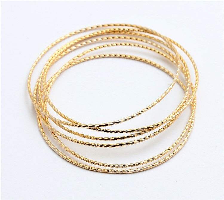 Six yellow gold bangles. Indonesia