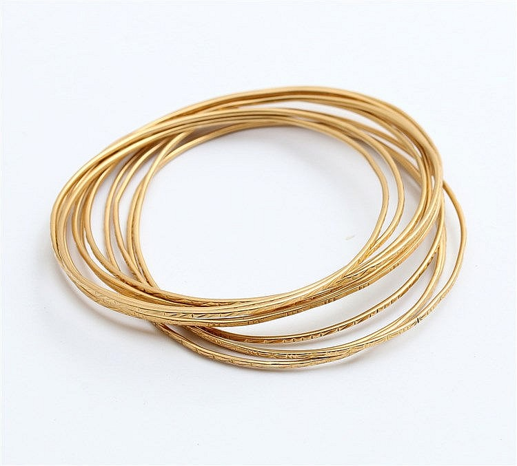 Eleven yellow gold bangles. Indonesia