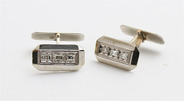 Diamond set 18 krt white gold cuff links.