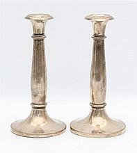 Pair of silver candle sticks by Mayerhofer & Klinkosch, Vienna,