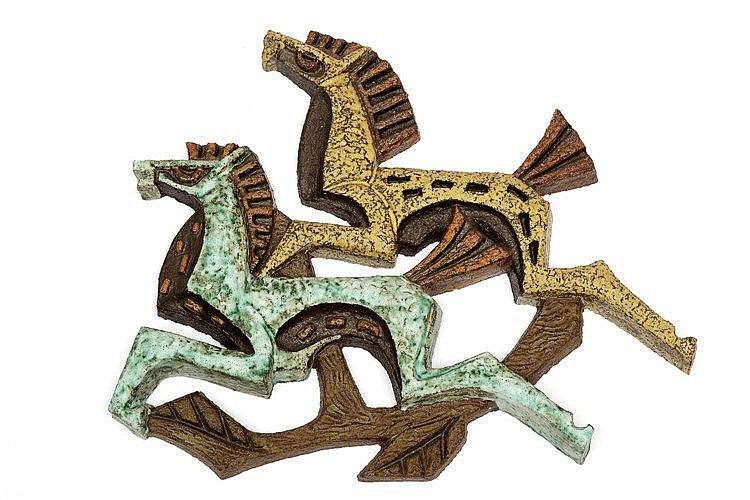 Joop Puntman (1934-2013)  A ceramic wall sculpture of two running horse