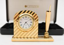 A brass CITIZEN desk clock with penholder