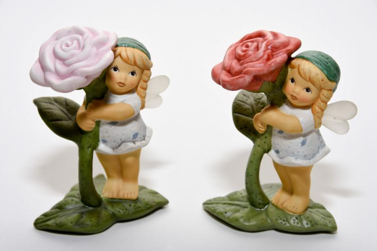 A pair of Ceramic Goebel figures