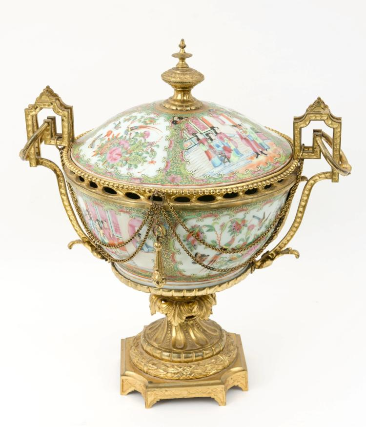 A large Chinese famille verte porcelain centerpiece with French ormolu mounting