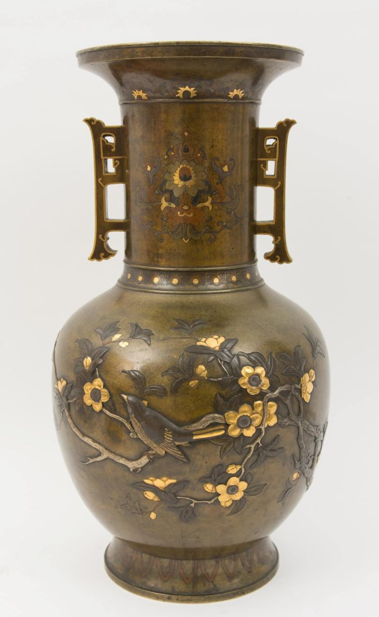 A large Japanese Meiji bronze vase with two handles