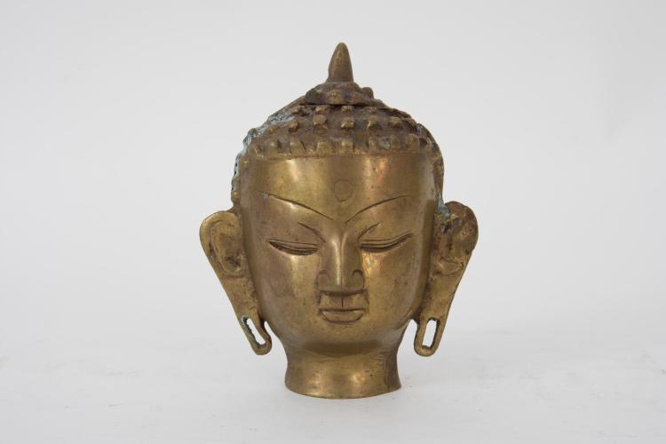A small brass Buddha head