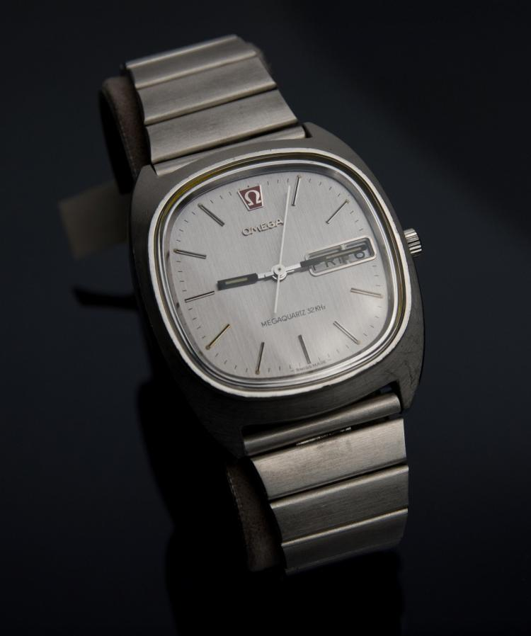 An Omega Megaquartz steel wristwatch