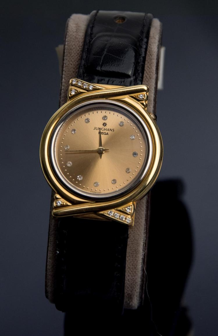 A Junghans Mega lady`s 18K gold wristwatch