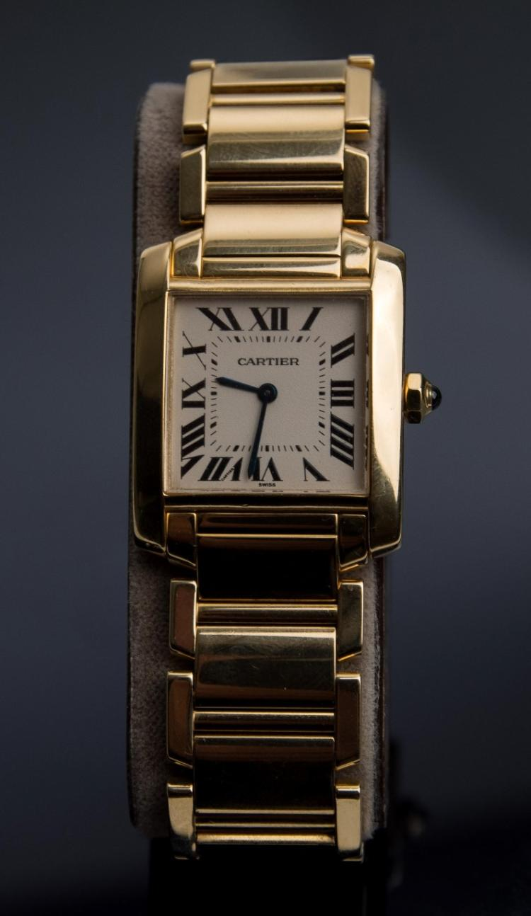 An 18K gold Cartier Santos Demoiselle lady`s wristwatch
