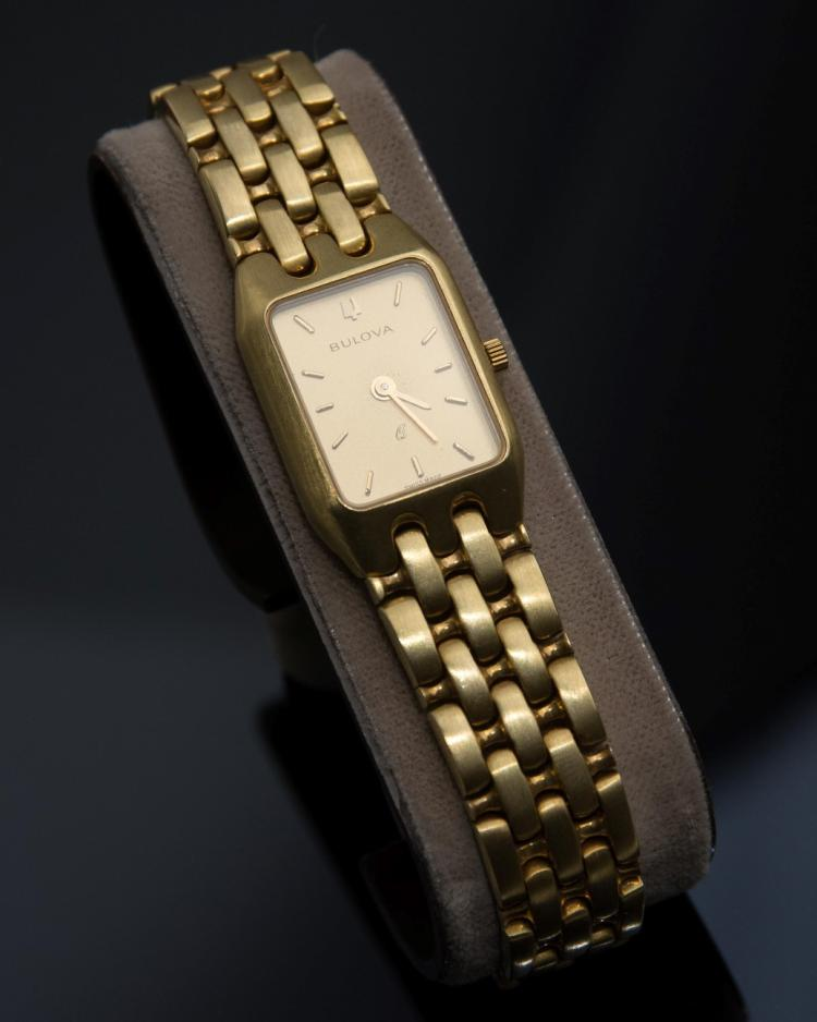 An 14K gold Bulova lady's wristwatch