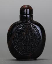 Chinese carved tiger eye snuff bottle