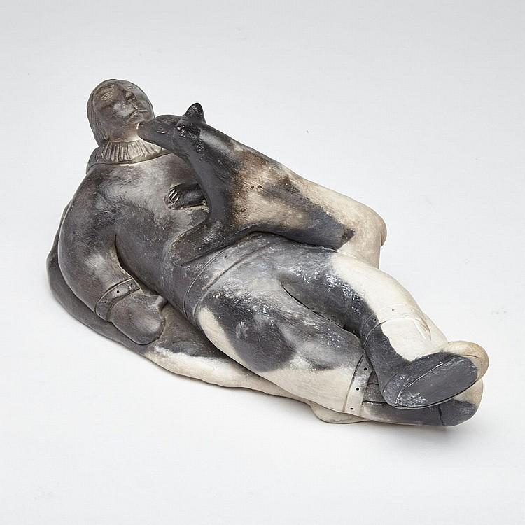 ROGER AKSADJUAK (1972-), RECLINED MAN AND HIS DOG, ceramic, 4.5