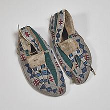 Pair of Lakota Moccasins Formerly Property of Holy Man and War Chief of the Hunkpapa Lakota Sioux, Sitting Bull (1831-1890), 19th century, length 9.25