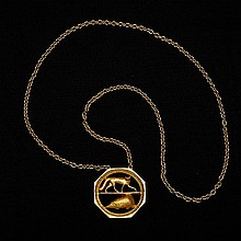 DAVID ALEXANDER COLVILLE, R.C.A., FOX AND HEDGEHOG, openwork 18 carat gold pendant on a chain, diameter 1.75 ins; 4.4 cms