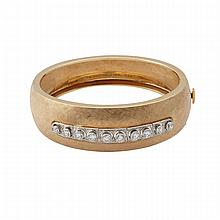 14k Yellow Gold Hinged Bangle, with a white gold center panel set with 10 European cut diamonds (approx. 1.80ct.t.w.)