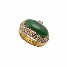 18k Yellow Gold Ring, set with a jadeite saddle cabochon encircled by 50 brilliant cut and 6 baguette cut diamonds (approx. 1.10ct.t.w.)