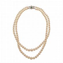 Double Strand Graduated Cultured Pearl Necklace, (5.00mm to 8.70mm) completed with a platinum clasp set with 14 baguette, Swiss and brilliant cut diamonds (approx. 0.60ct.t.w.) and a small emerald cut emerald