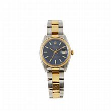 Men's Rolex Oyster Perpetual Date Wristwatch, circa 1966; reference #1505; case number 1755494; movement 1570; blue dial; in a stainless steel case with gold trim, crown and bezel