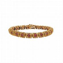 Tiffany & Co. 18k Yellow Gold Bracelet, set with 18 full cut rubies (approx. 1.50ct.t.w.)