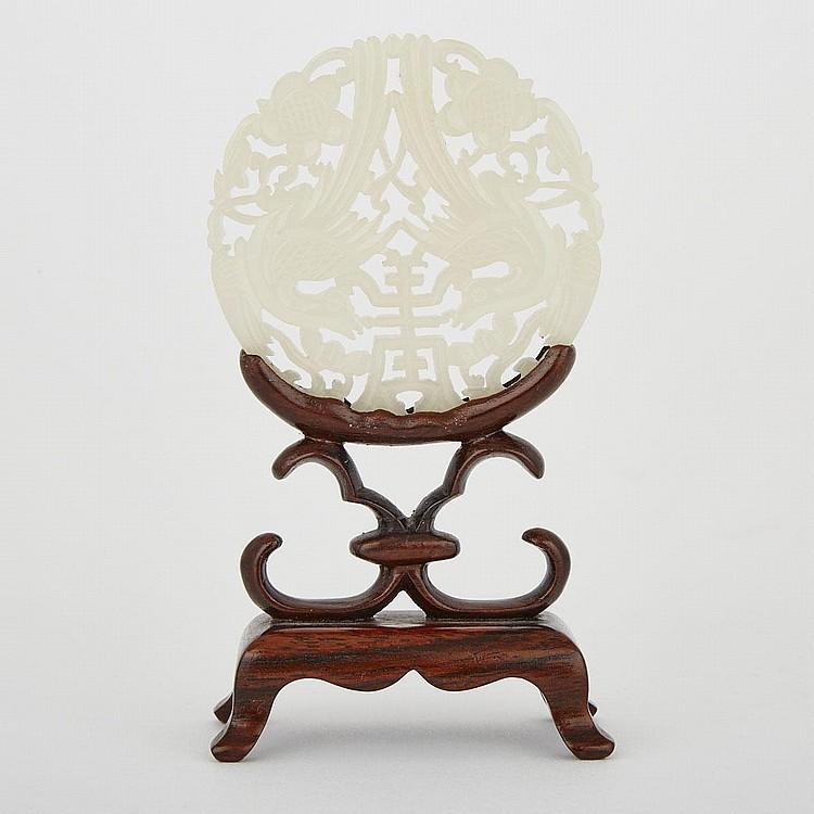 A Celadon White Jade Plaque, 20th Century, diameter 2.5