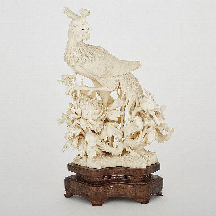 An Ivory Carving of a Phoenix, Early 20th Century, (including base) height 9.6