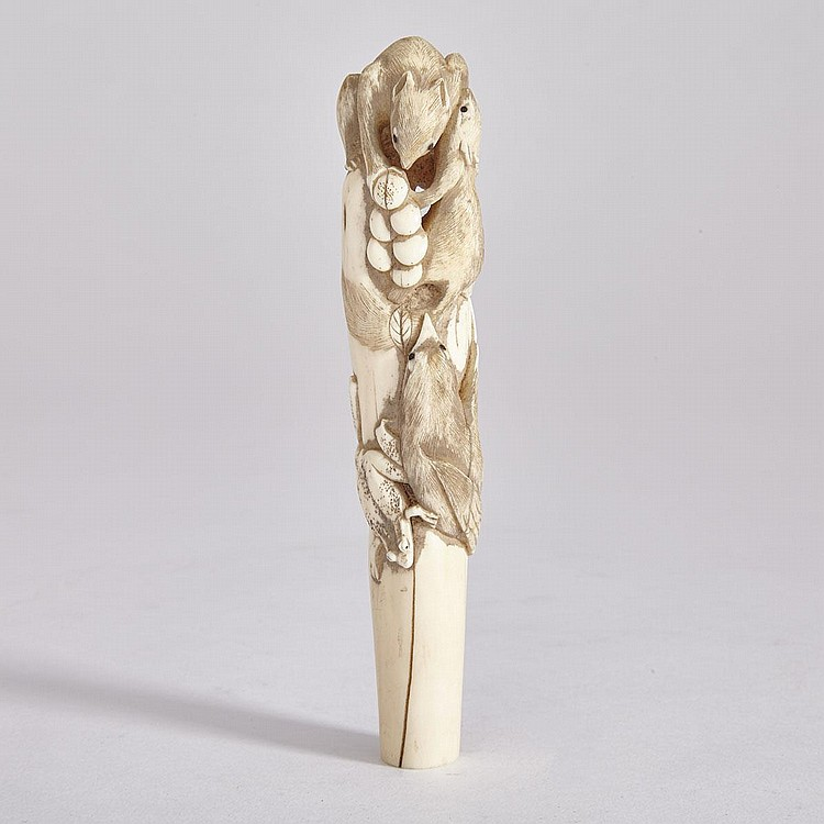 A Carved Japanese Ivory 'Squirrels and Grapes' Cane Handle, Meiji Period, height 6