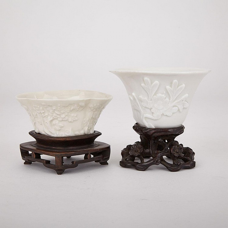 Two Blanc de Chine Dehua Libation Cups, 18th Century, tallest without stand height 2.2