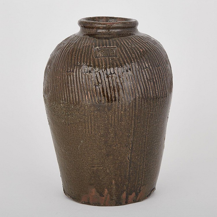 A Southeast Asian Black Glaze Storage Jar, 15th Century, height 13