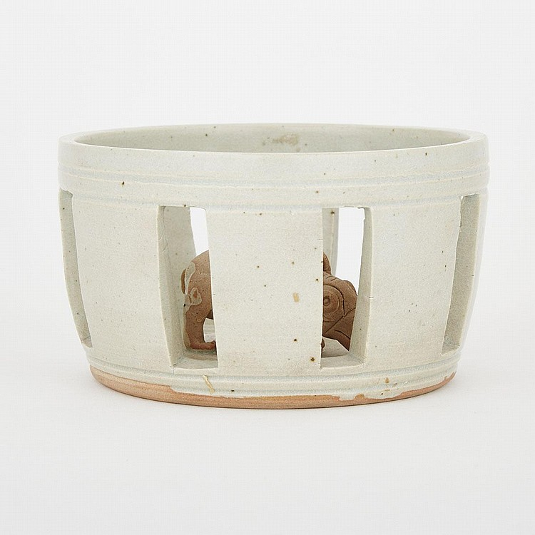 A Rhino Cage Pottery Figure, 3.3