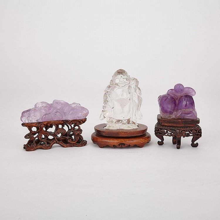 Two Carved Lavender Crystal and a Rock Crystal Budai, 19th/20th Century, tallest without stand height 3.7